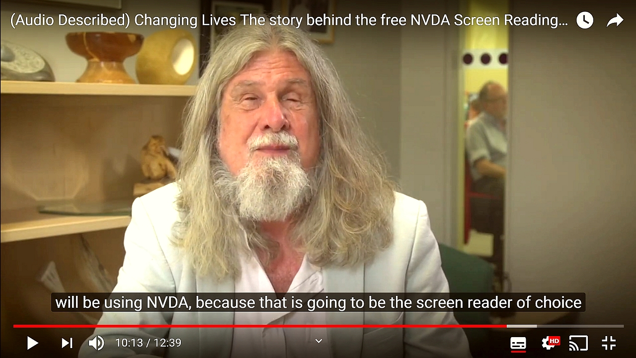 "Screenshot from ""Changing Lives: The story behind the free NVDA screen reader"". Kevin Carey (Chair RNIB), subtitle text ""will be using NVDA because that is going to be the screen reader of choice""."