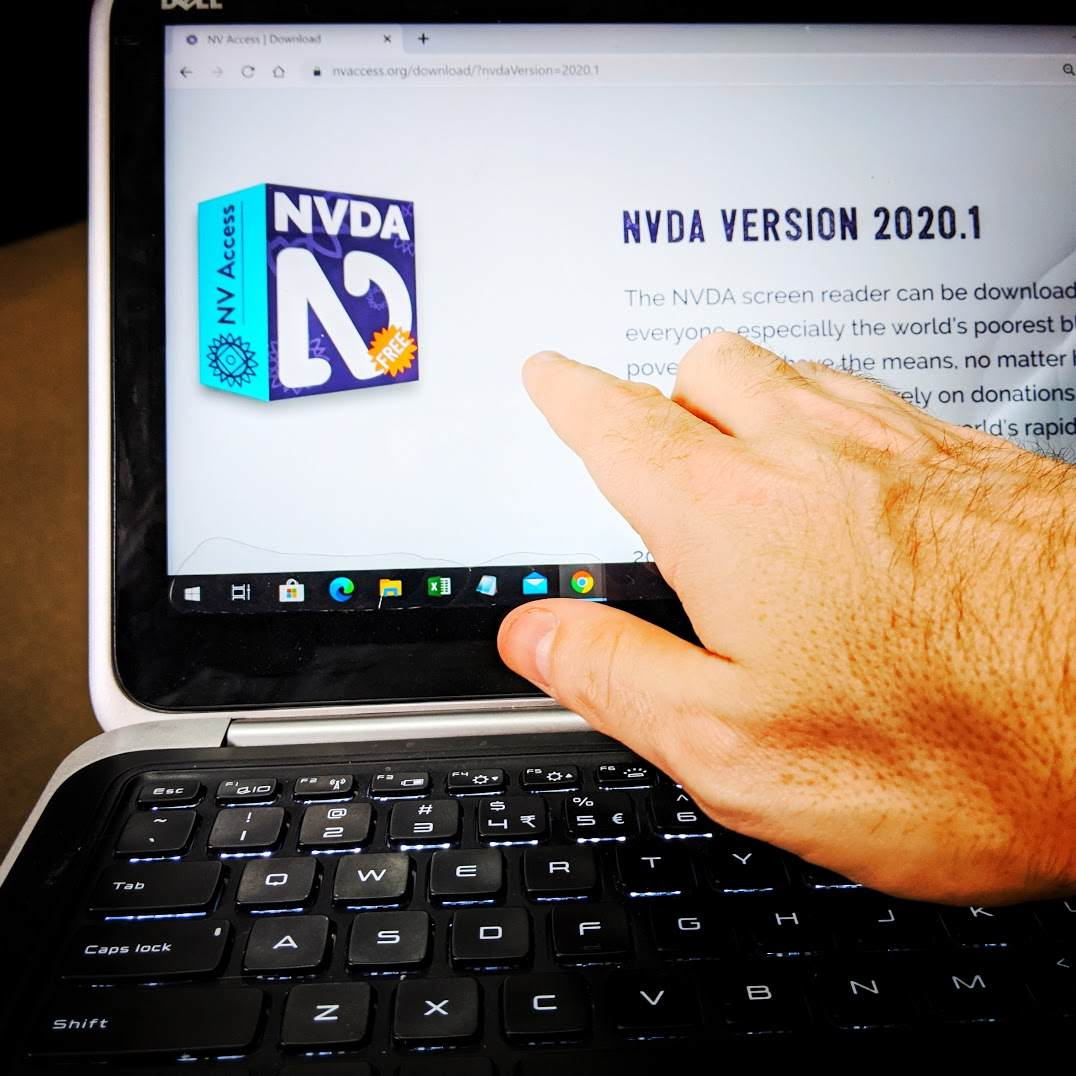 Hand reaching for laptop touch screen showing NVDA download