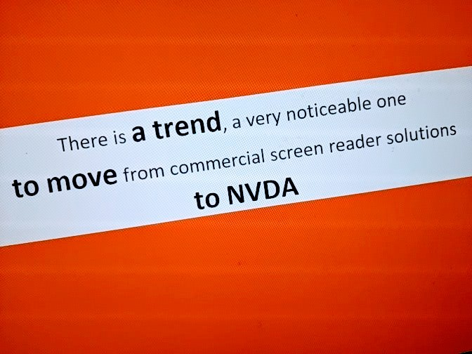 "Text: ""There is a trend, a very noticeable one, to move from commercial screen reader solutions to NVDA"", in purple on a white block, on an orange background."